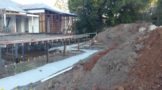 Retaining wall footings, rear deck
