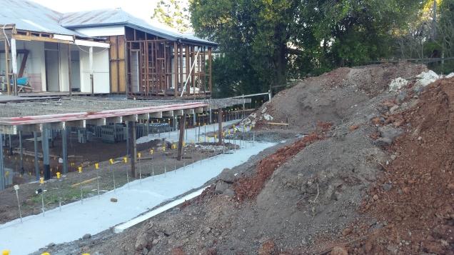 Retaining wall footings, rear deck