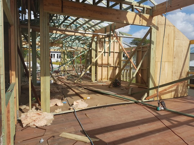 Internal framing - front deck in the foreground, through to the living room, then kitchen, then rear deck. Queenslander renovation