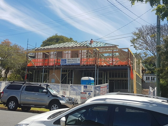 Trusses starting to be fixed into place, the day after they arrived on site - Queenslander renovation