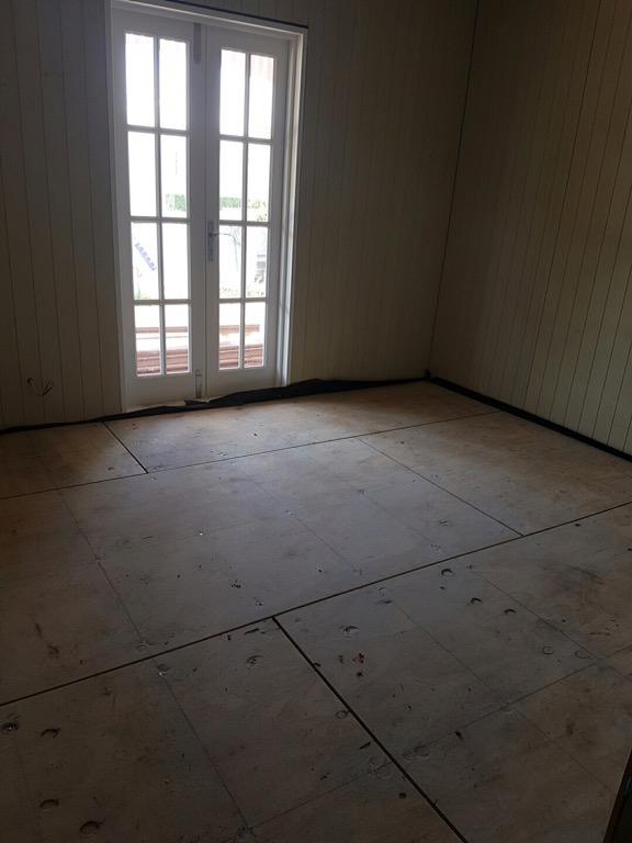 Downstairs bedroom - VJ walls but no floorboards