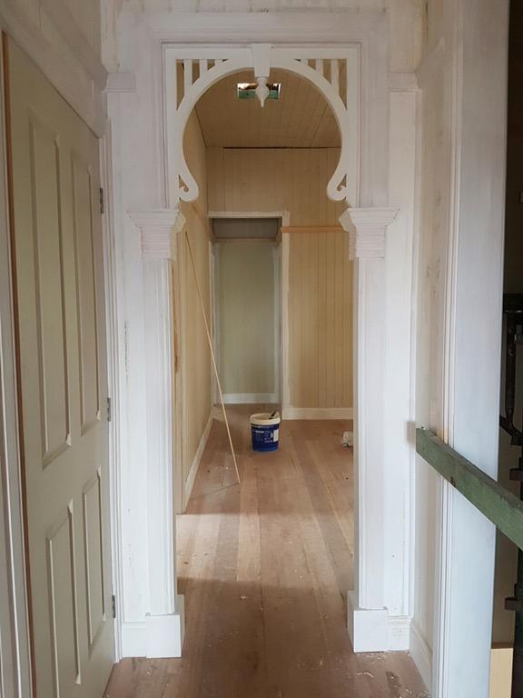Hallway corridor with decorative archways - Queenslander