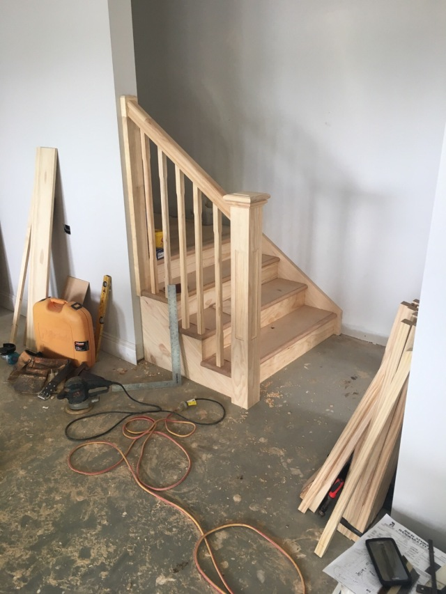 Internal stairs leading from the garage to the bottom level of the house